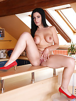 Hot wife gets hot and horny in the kitchen playing with her shaved twat