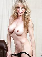 Big tit mom rubs her clit until she cums